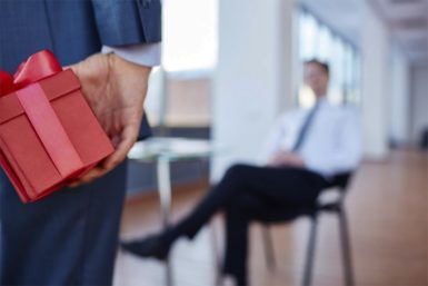 Businessman going to give present to his boss